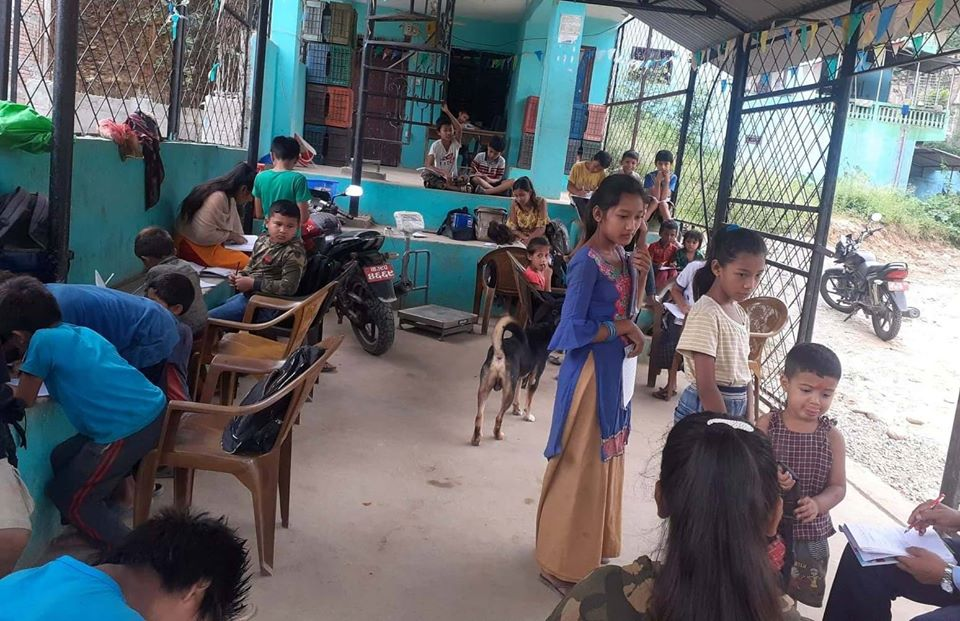 Community school teachers run classes in their own locality to help children continue their studies