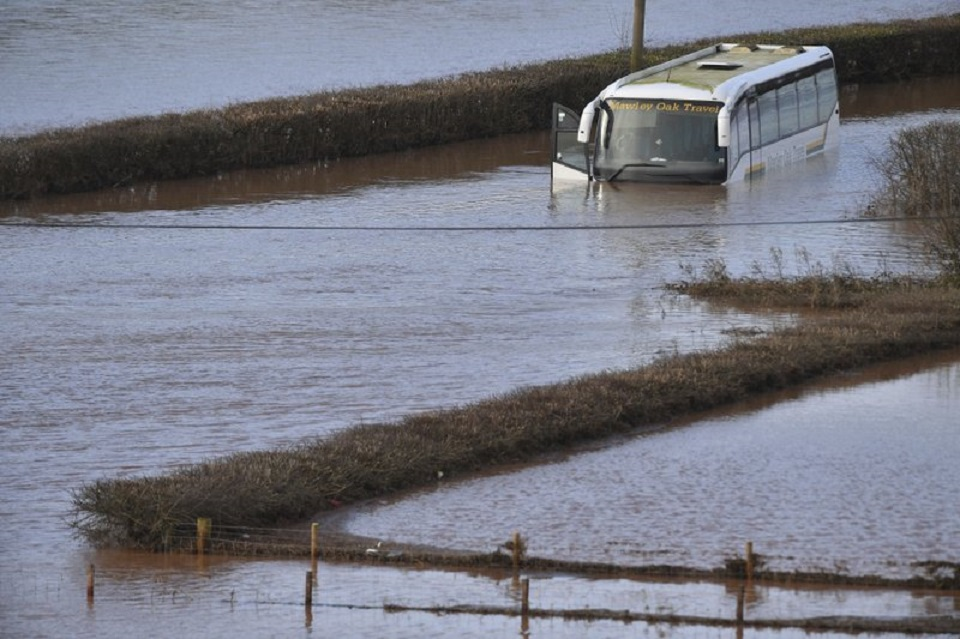 UK issues severe flood warnings; storm injures 9 in Germany