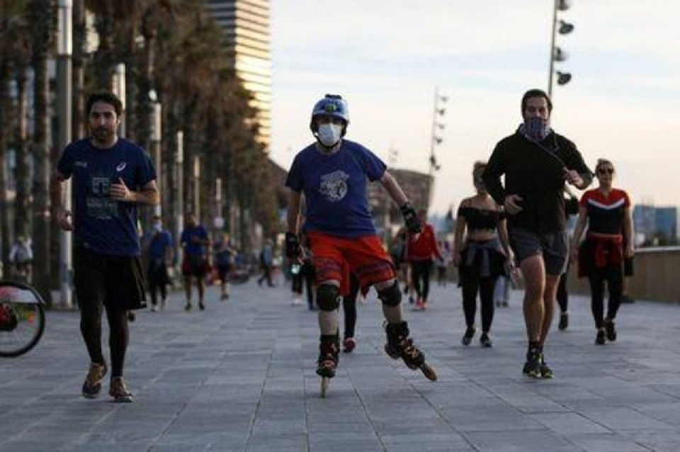 Adios, indoor jogging! Spaniards get outside to exercise after 49 days of lockdown