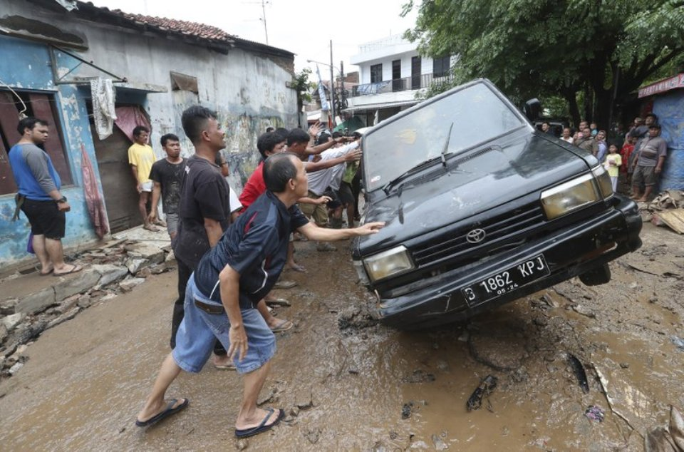 Indonesia plans cloud seeding to halt rain, floods death toll rises to 43