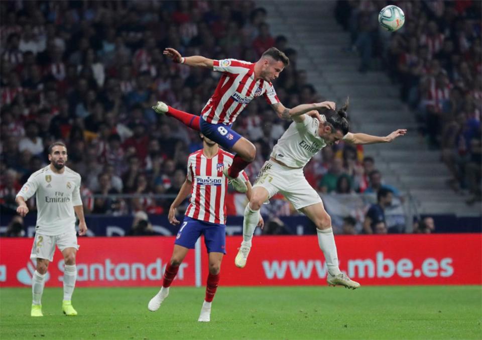 Real top La Liga after derby draw at Atletico