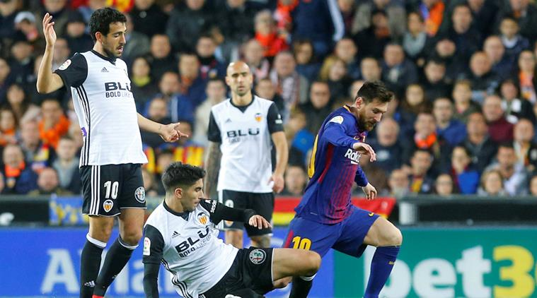 Barca draw at title rivals Valencia after goal-line controversy