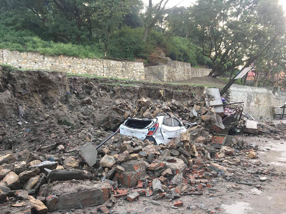 Newly built wall collapses after hailstorm