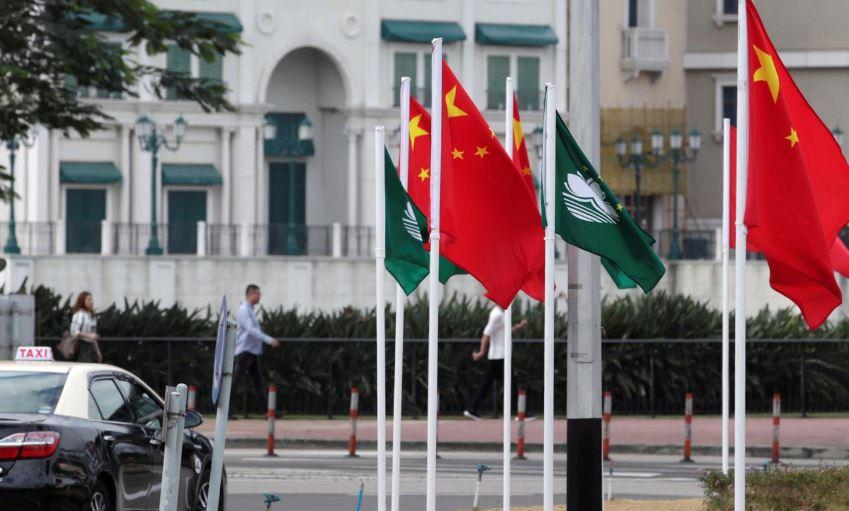 Chinese leader Xi visits gambling hub Macau as nearby Hong Kong seethes