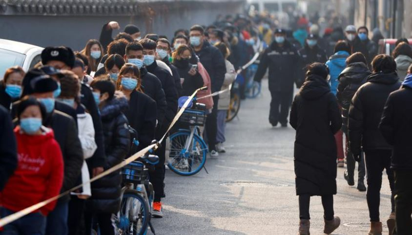 Long queues as China's capital launches mass virus tests