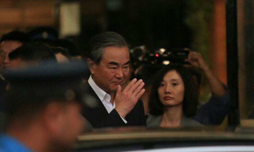 Chinese FM Wang returns home