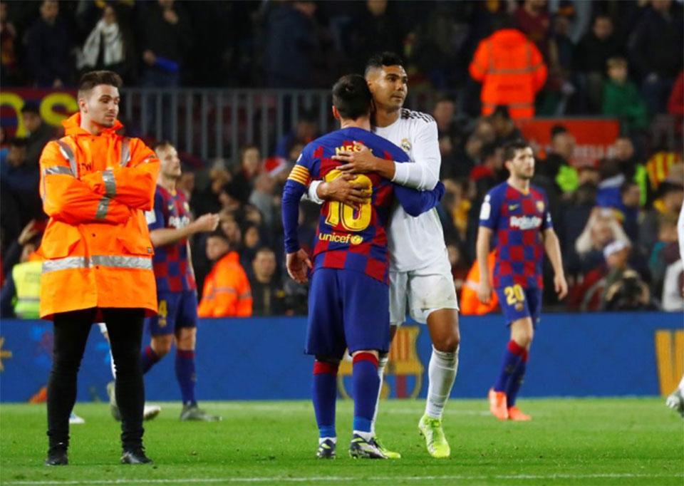 Barca, Real share spoils in rare goalless 'Clasico'