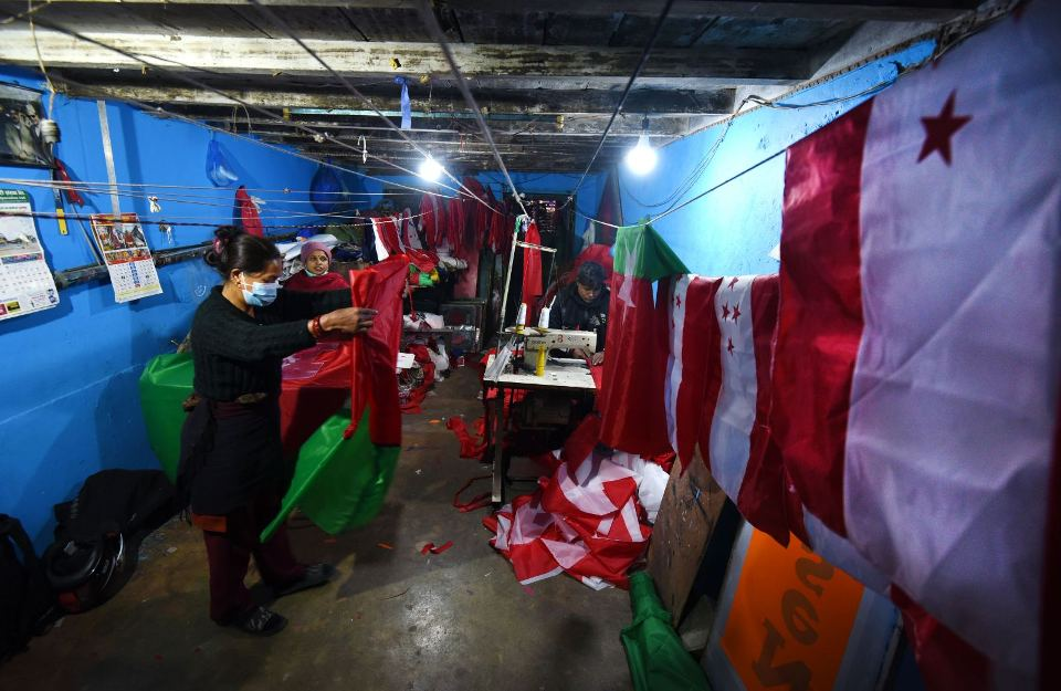PHOTOS: With political protests on the rise, flag-makers have a brisk business