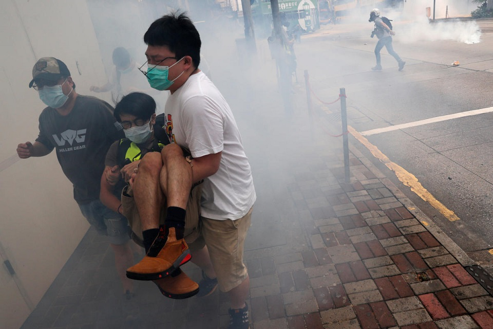 Hong Kong police fire tear gas as protesters rise up against security law
