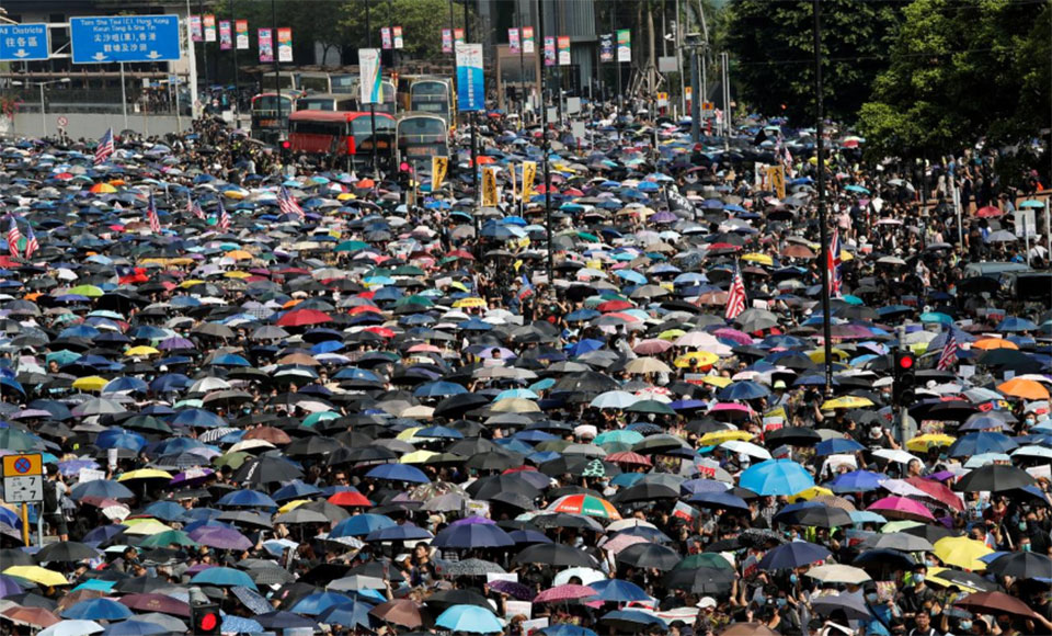 Thousands of Hong Kong protesters stage illegal march; metro stations close