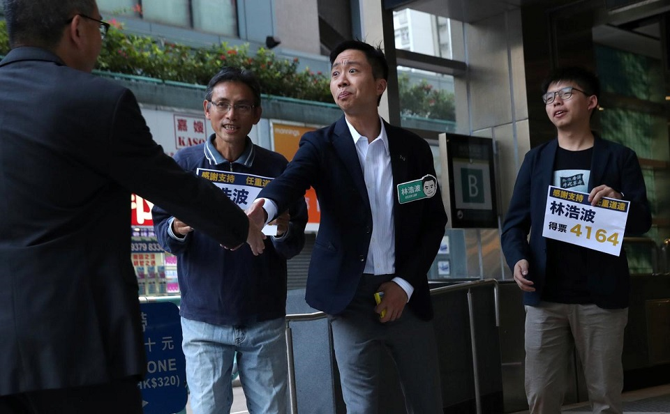 Hong Kong democrats romp to local election landslide after months of protests