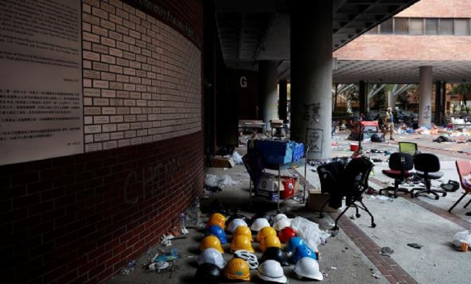 Protesters stay holed up on Hong Kong campus, surrounded by riot police