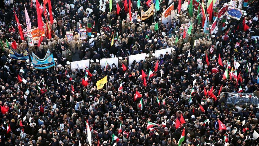 Huge crowds in Iran for commander's funeral, daughter warns U.S. of 'dark day'
