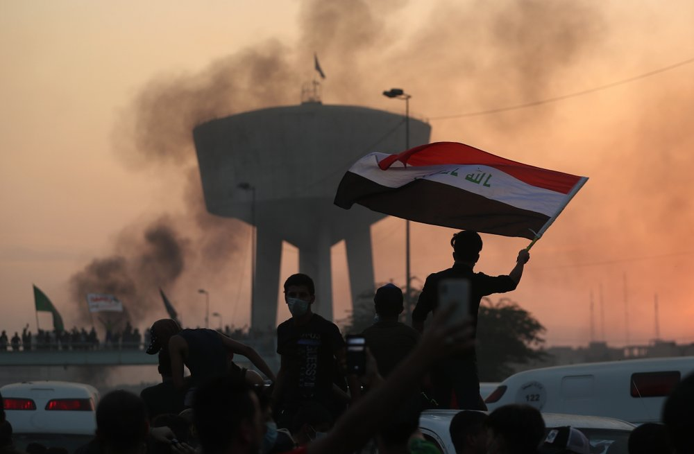 Curfew, more tear gas in Baghdad after 2 days of violence