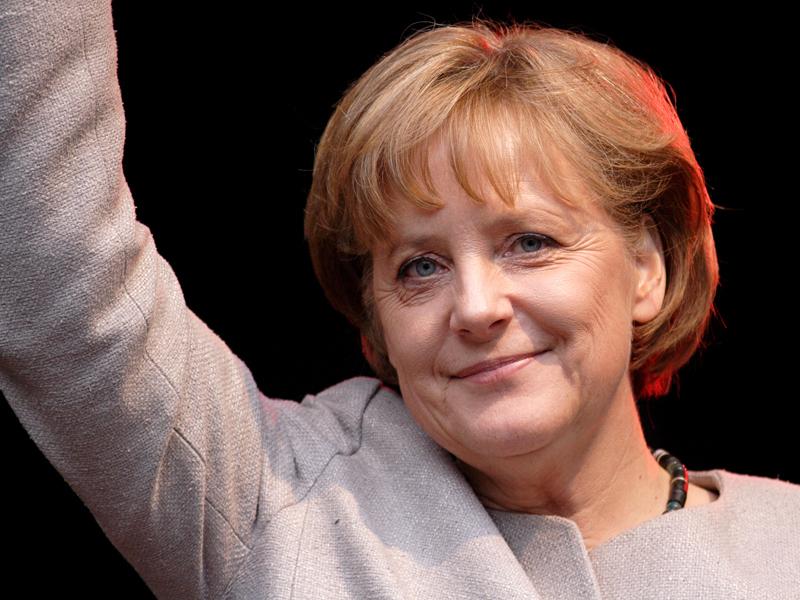Merkel pledges big effort to hold EU together