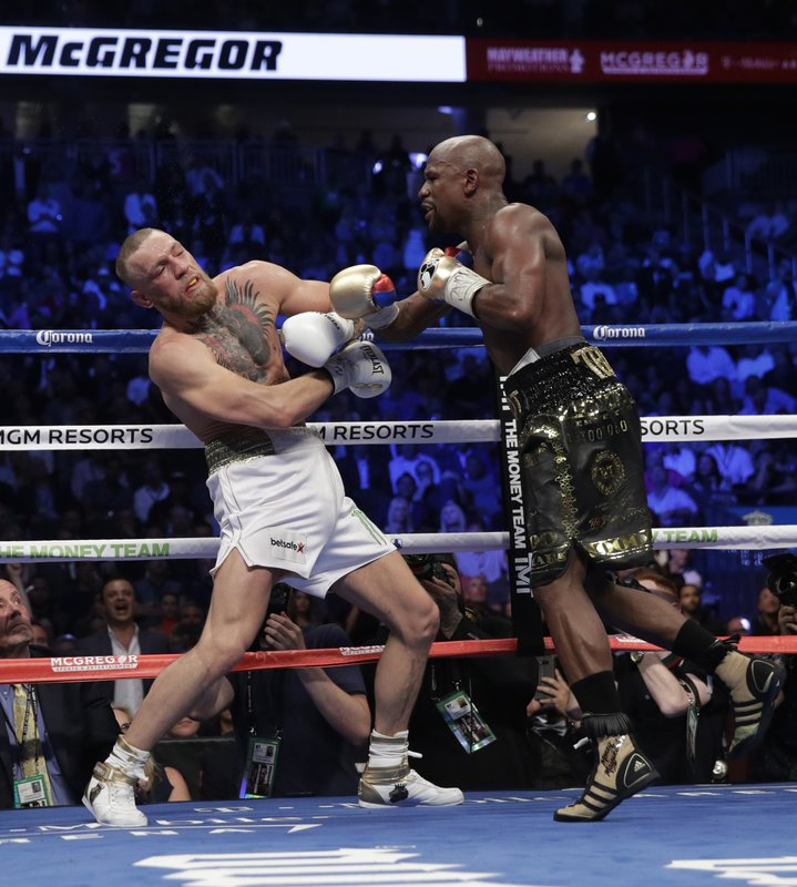 Mayweather dominates McGregor in late rounds to go 50-0