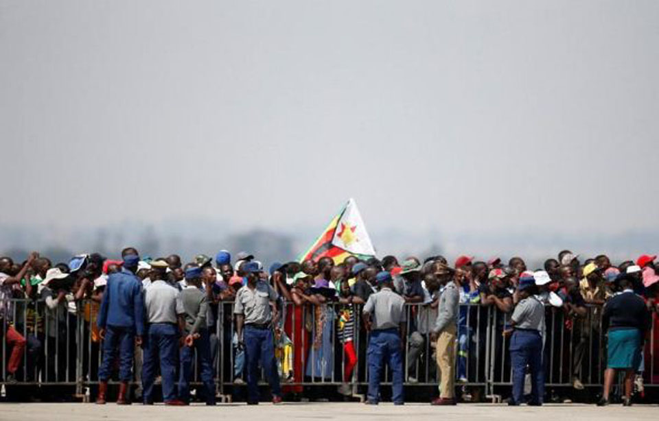 Mugabe's body brought home to Zimbabwe, burial place still a mystery