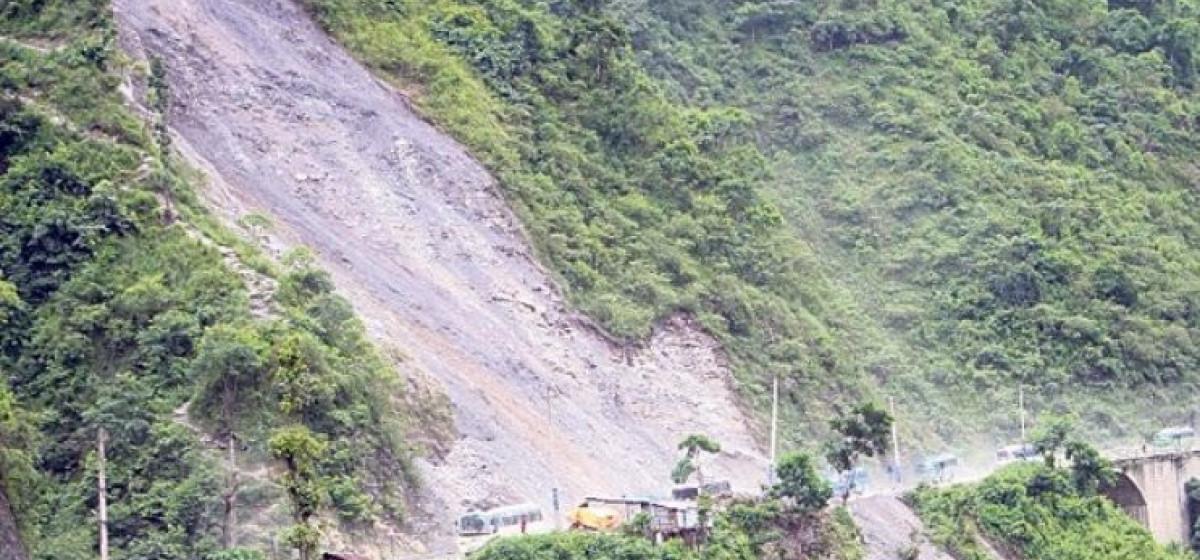 Two weeks on, the road blocked by landslide-debris yet to resume