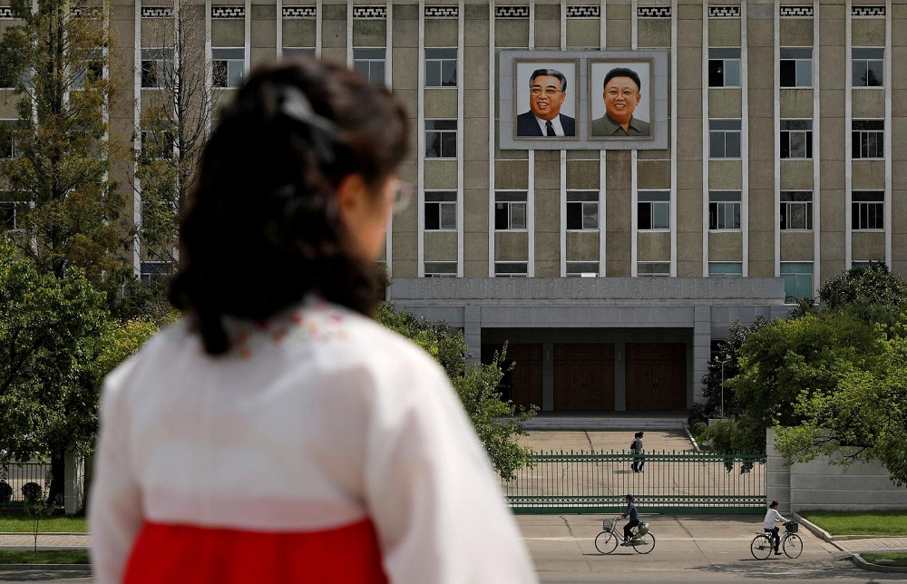 N.Korea calls for tougher virus curbs, but leader wears no mask in photographs