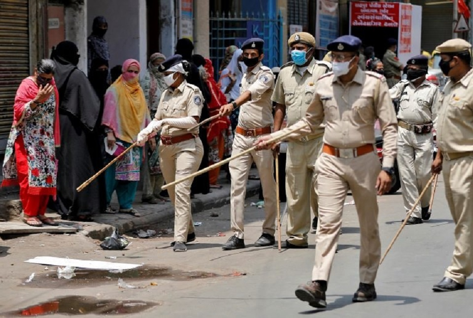 Coronavirus spreads among Indian police enforcing world's largest lockdown