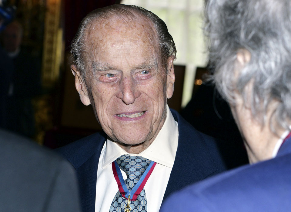 Prince Philip, 95, keeps calm but won't carry on royal duty