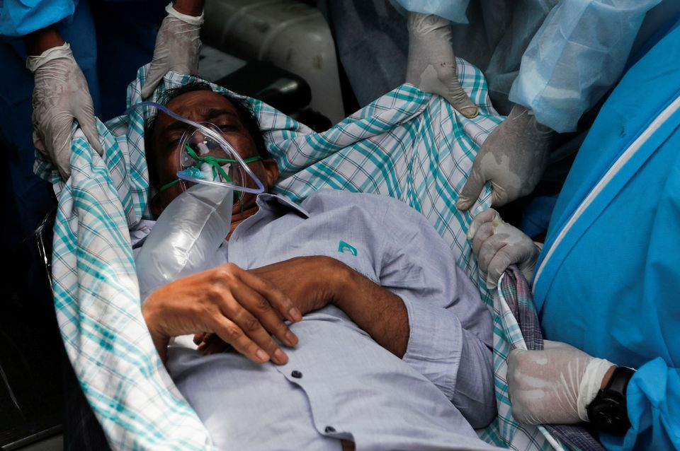 Hospitals overrun as India's COVID-19 infections top global record for second day