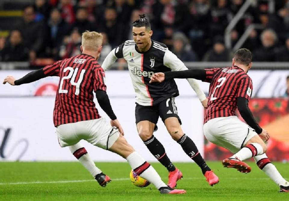 Ronaldo penalty earns Juve draw at 10-man Milan