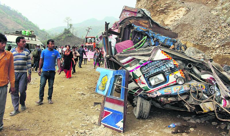 Two killed as landslide buries vehicles