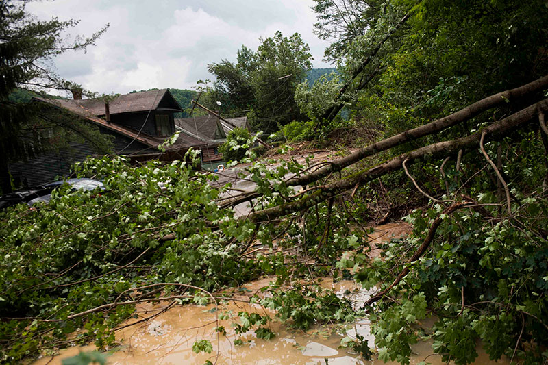 Crews rescue the stranded in West Virginia flooding; 23 dead