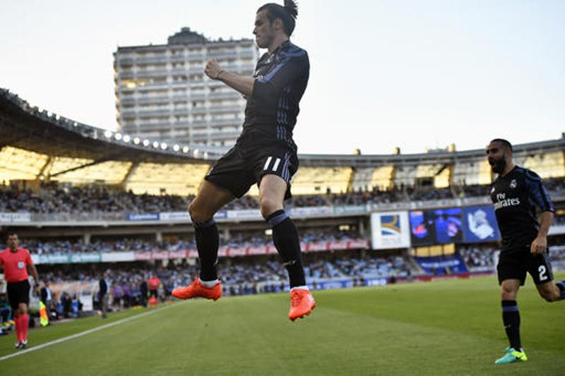 Bale ensures Real Madrid's winning start, Atletico draws