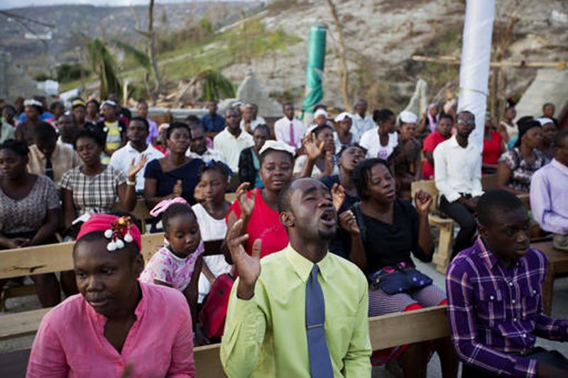Haitians worship among devastation caused by hurricane