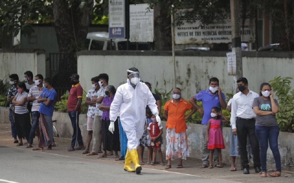Sri Lanka bans public gatherings amid sharp rise