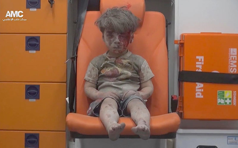 Haunting image of Syrian boy rescued from Aleppo draws outrage