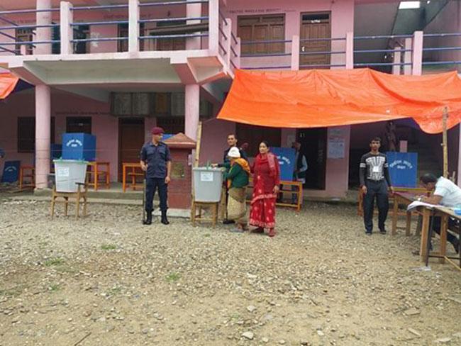 101-year-old Tulasa Devi Aryal casts her vote in Gulmi