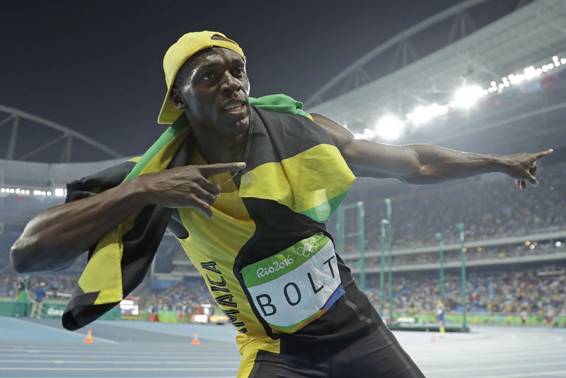 Bolt shines bright, wins another gold in Olympic 100