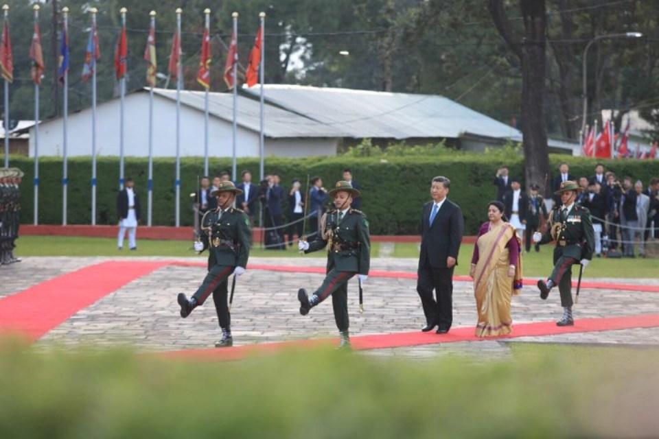 Xi, Bhandari inspect guard of honor at TIA