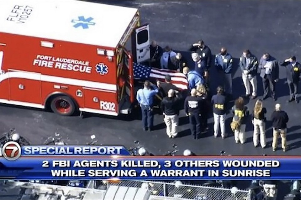 Two FBI agents killed, three wounded in early morning raid in Florida