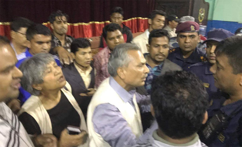 Police manhandle Dr. Bhattarai