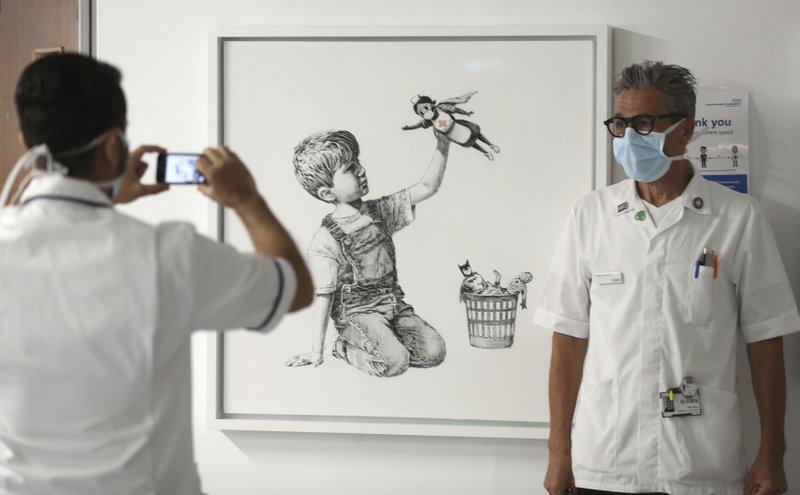 Banksy painting raises $23 million for UK health charities