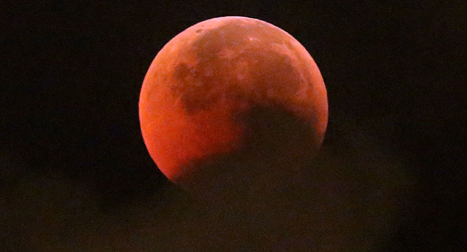 World marvels at longest 'Blood Moon' eclipse expected for a century (PHOTOS)