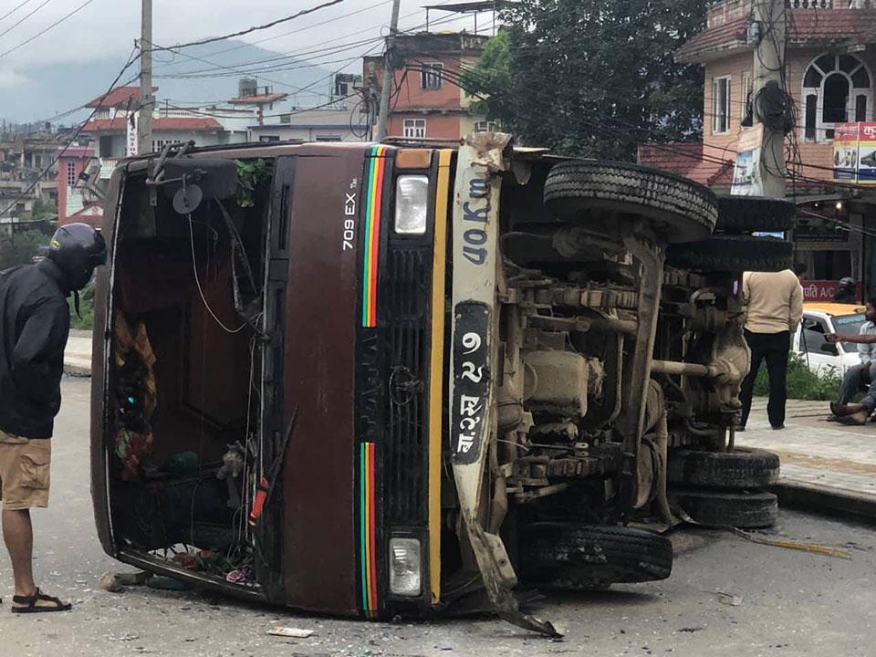 Two children injured after passenger bus overturns