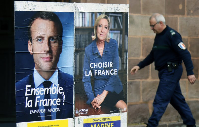 As bitter French campaign ends, Macron's team hit by hack