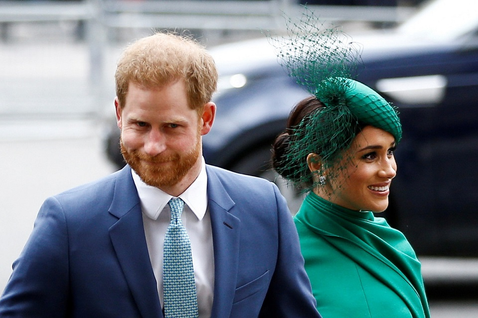 Prince Harry and wife Meghan bid farewell to royal roles