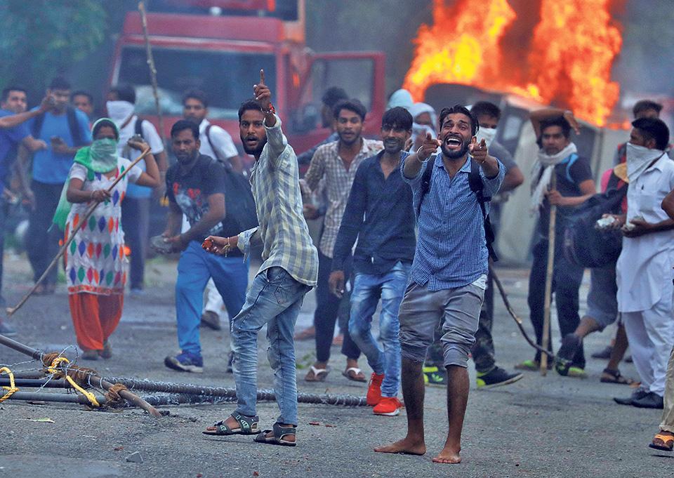 India detains hundreds, after deadly 'godman' protests