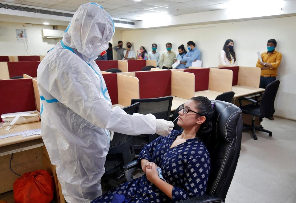 India reports record daily jump of 83,883 coronavirus infections