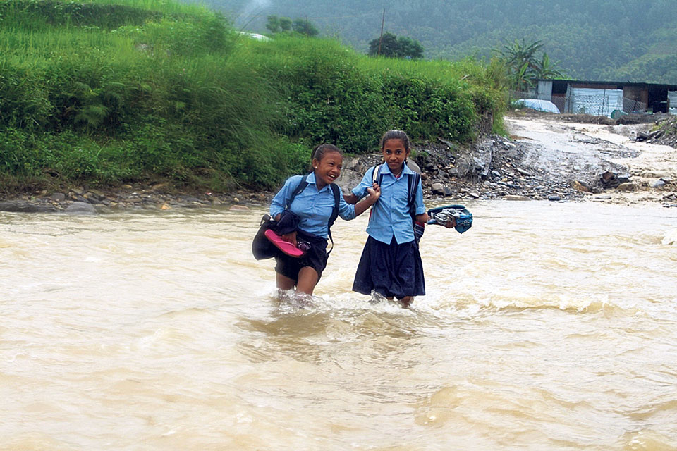 Children compelled to cross raging monsoon river to get to school