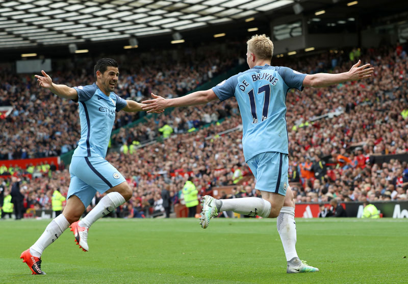 First blood to Guardiola as Man City win derby