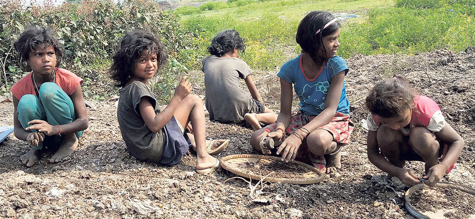 Children scavenging on scrap to pay for their education