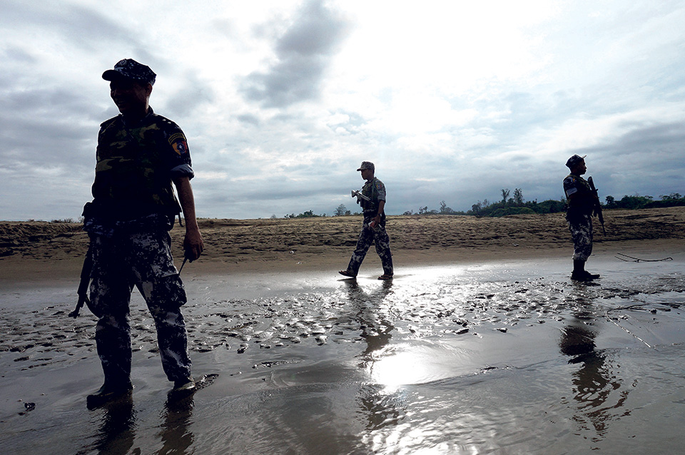 Myanmar says soldiers, police facing action over village killings