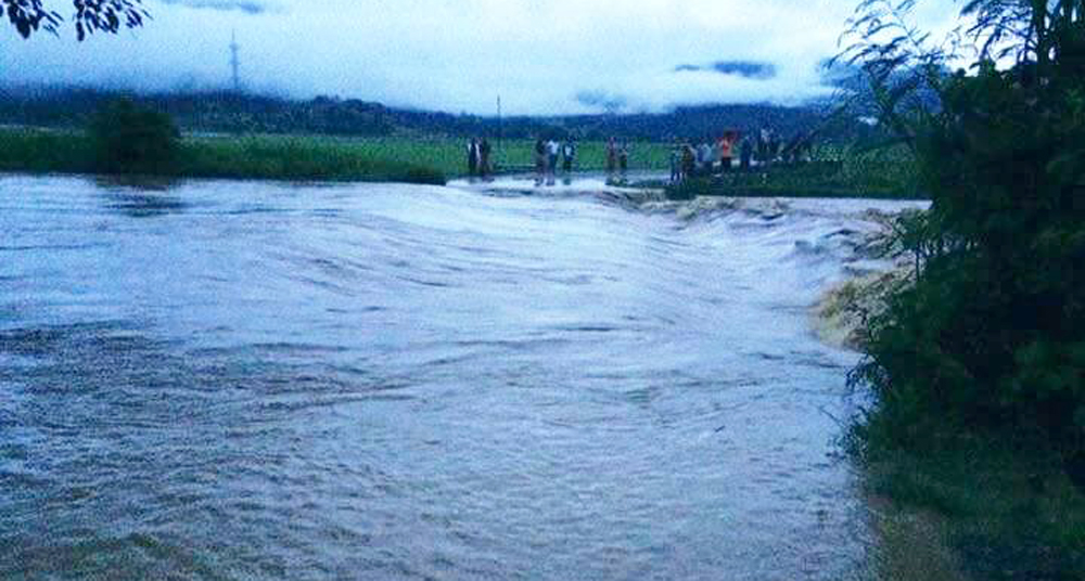 4 passengers swept away by river
